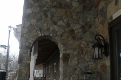 Stone archway into covered walkway